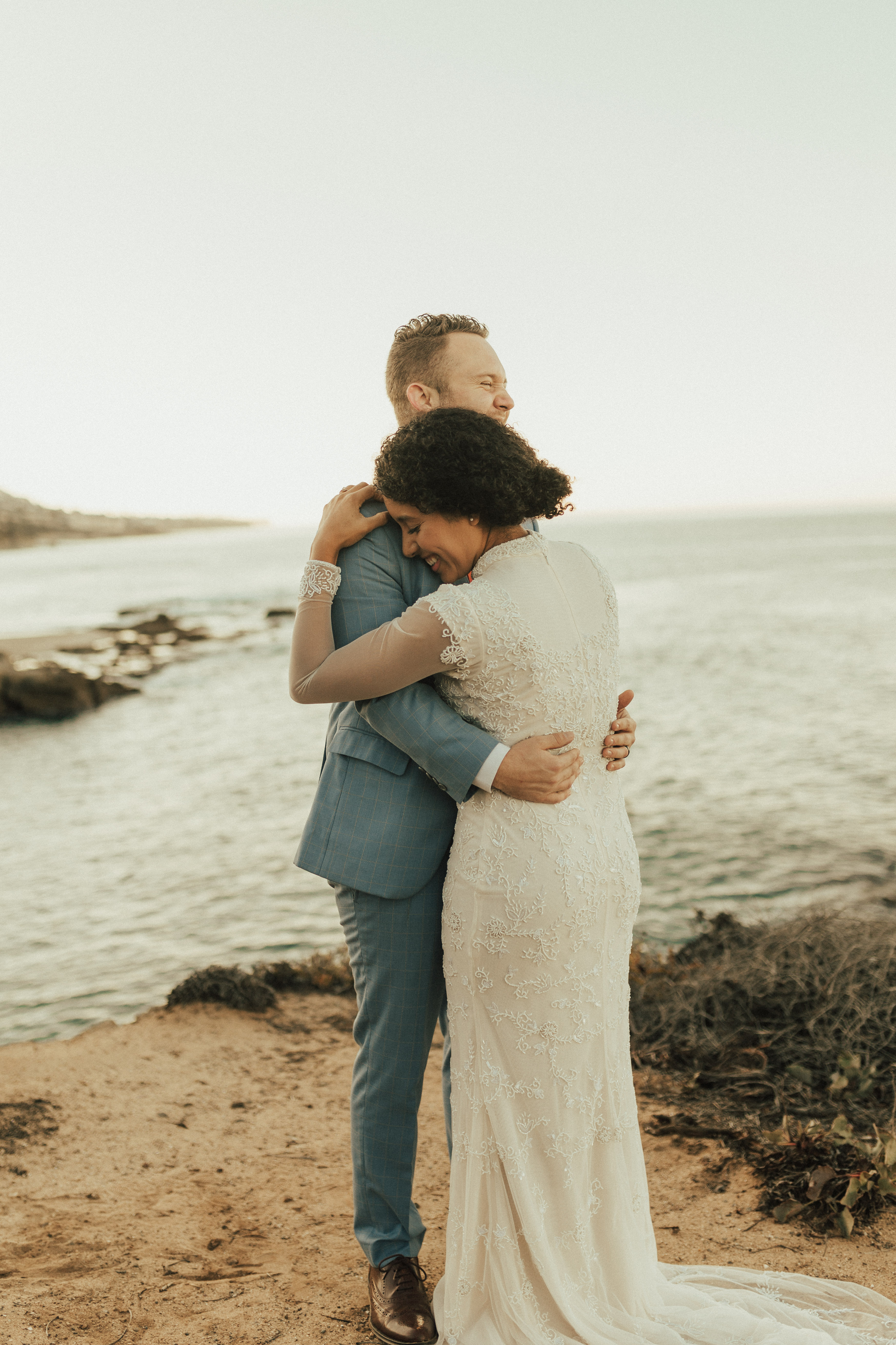wedding photos at remote california beach with bridal gown